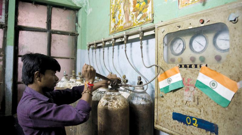A file photo of a hospital staff member checks newly-arrived oxygen cylinders at Baba Raghav Das Medical College Hospital in Gorakhpur, Uttar Pradesh. Thirty-three children died on August 10 and 11 at the BRD Medical College in Gorakhpur, around the time there was a disruption in the oxygen supply. (Photo: AP )