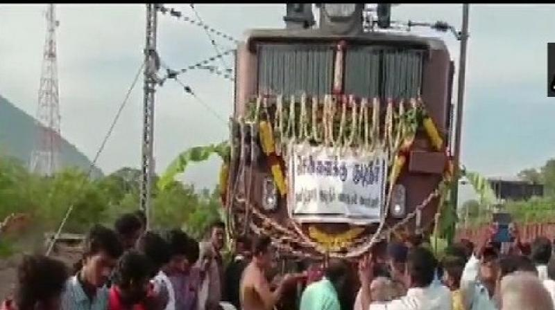 Technicians in the railway station at Jolarpettai, located over 135 miles (217 km) from Chennai, worked from early on Thursday to fill fifty wagons with 50,000 litres of water each, sourced from a south Indian river. (Photo: ANI)