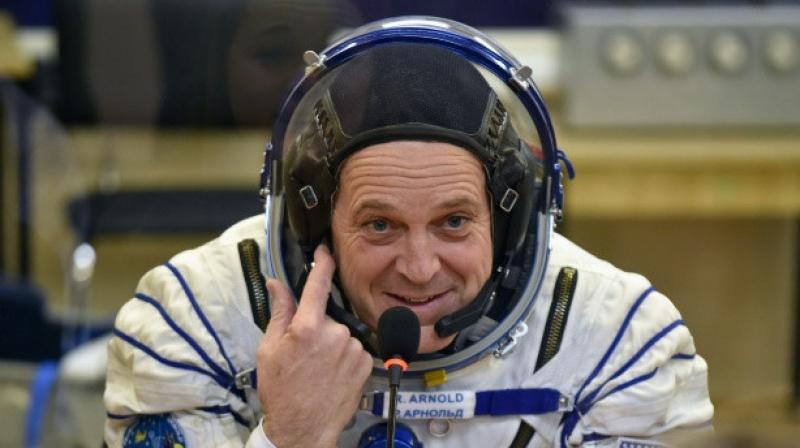 US astronaut Richard Arnold shown here before heading to the International Space Station is one of two Americans undertaking a space walk. (Photo: AFP)