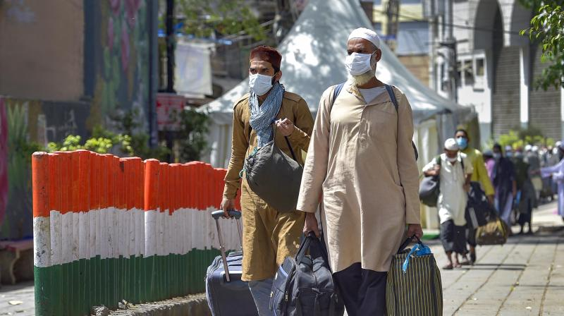 People who came for 'Jamat', a religious gathering at Nizamuddin Mosque, being taken to LNJP hospital for COVID-19 test, after several people showed symptoms of coronavirus, during a nationwide lockdown, in New Delhi. PTI Photo