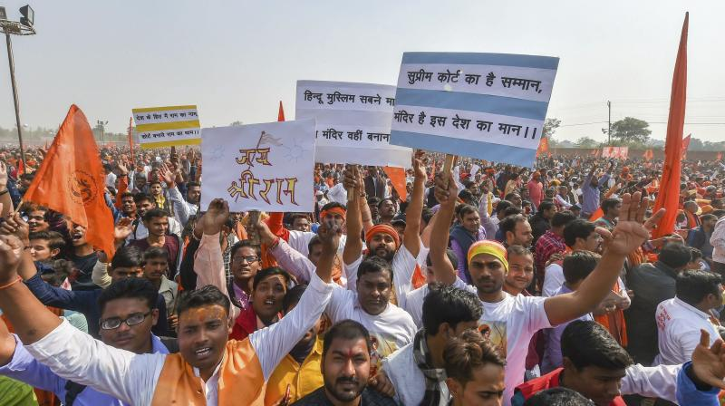 Supporters participate in 'Dharam Sabha', being organised by the Vishwa Hindu Parishad to push for the construction of Ram temple on Sunday. (Photo: PTI)