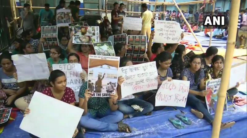 'We will continue with our agitation till our demands are fulfilled. We have spoken to the Governor. He listened to us and hopefully will speak to the chief minister,' one of the junior doctors said. (Photo: ANI)