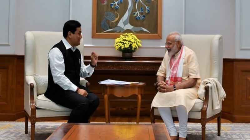 Chief Minister of Assam, Sabanand Sonwal with Prime Minister Narendra Modi on Wednesday in New Delhi. (Photo: Twitter   @PMOIndia)