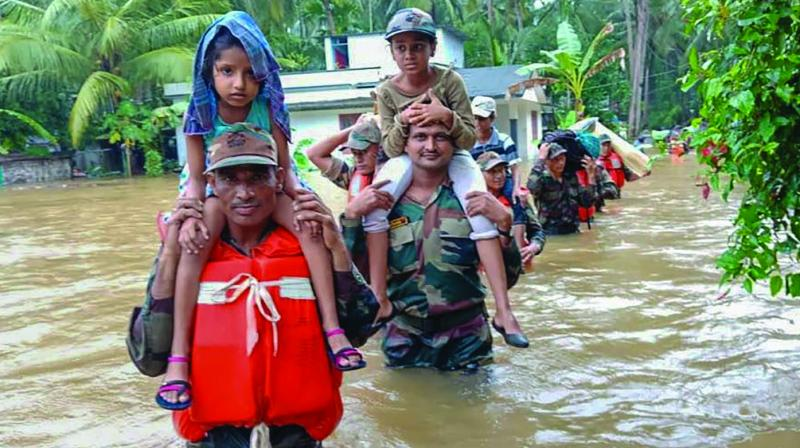 Army personnel on rescue and evacuation operations in a flood-affected region of Kerala. (Photo: PTI)