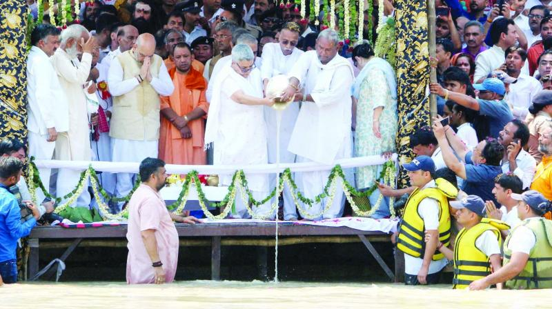 Former Prime Minister Atal Behari Vajpayee's daughter Namita Kaul Bhattacharya and son-in-law Ranjan Bhattacharya immerse his ashes in the Ganga at Har ki Pauri in Hardwar on Sunday. BJP president Amit Shah and Uttar Pradesh chief minister Yogi Adityanath are also seen. (Photo: PTI)
