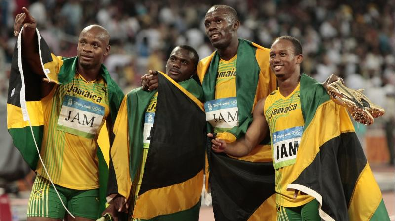 Usain Bolt, Nesta Carter, Asafa Powell and Michael Frater were on the Jamaican relay squad that was disqualified after Carter tested positive for the banned substance methylhexaneamine in a re-test of Beijing samples. (Photo: AP)