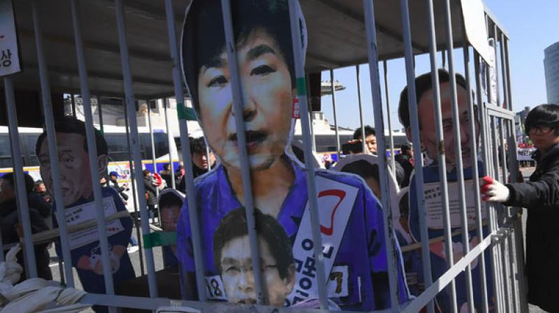 Protestors with an effigy of former President Park Geun-hye. (Photo: AFP)