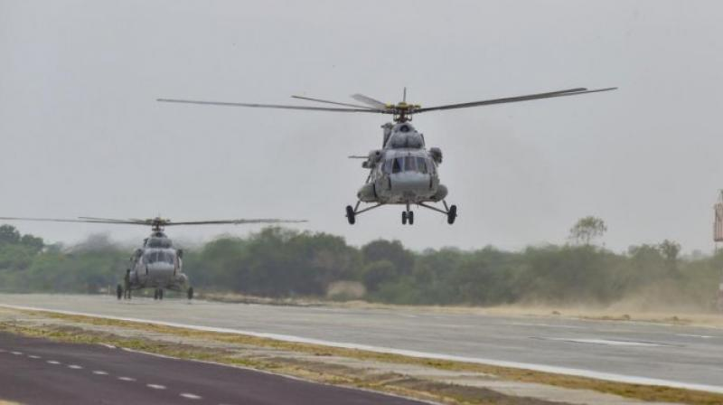 Indian Air Force Mi 17 helicopters take off as part of rehearsals before inauguration of an emergency landing strip at Gandhav Bhakasar section on NH-925 in Barmer district, Thursday, Sept. 9, 2021. (PTI)