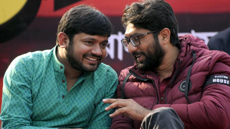 Student leader Kanhaiya Kumar and Gujarat MLA Jignesh Mevani during a rally to mark the 94th foundation day programme of Communist Party of India in Kolkata Wednesday. (Photo: Abhijit Mukherjee)