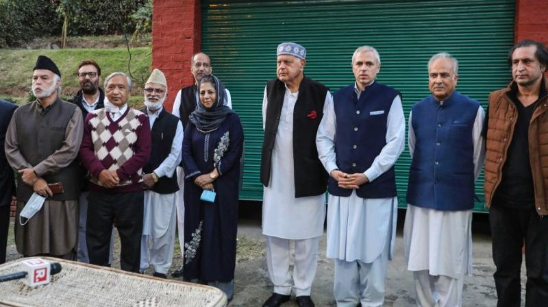 Jammu and Kashmir National Conference president Farooq Abdullah addresses a press conference along with his son Omar Abdullah, People's Democratic Party (PDP) president Mehbooba Mufti, People's Conference president Sajjad Gani Lone and others after meeting of signatories to the Gupkar declaration. (Photo: PTI/File)
