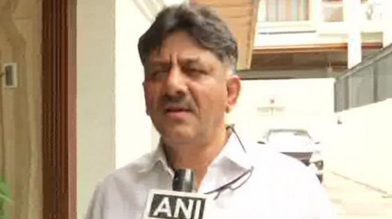 'They are not happy with the election results but the people of Karnataka are happy with our government,' said Shivakumar. (Photo: ANI)