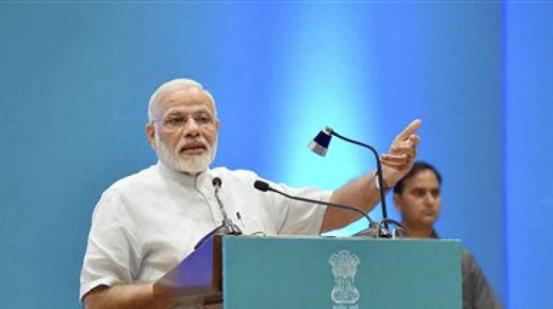 The Prime Minister told the government officials that the world is looking up to India with positive expectations and the entire world feels that a successful India is vital for global balance. (Photo: PTI)