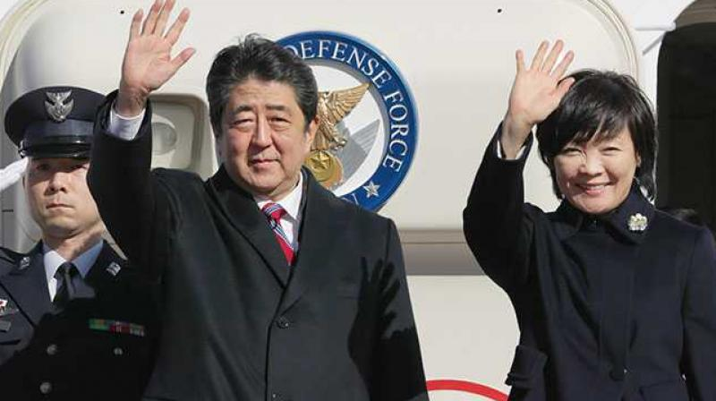 Shinzo Abe, wife Akie while boarding the PM's official plane, one of which has lost a wing panel (Photo: AFP)