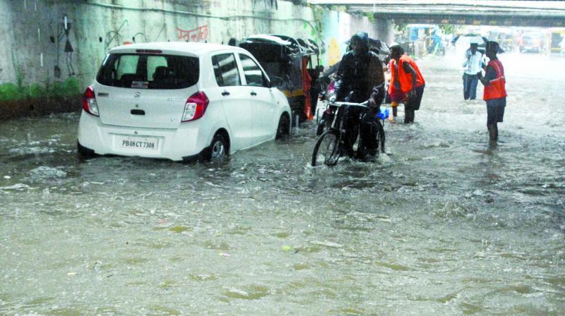 A subway in Andheri is waterlogged due to heavy showers on Tuesday. (Photo: Mrugesh Bandiwadekar)