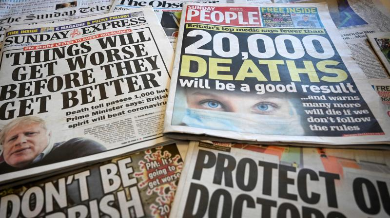 British Sunday newspapers on March 29, 2020, carry stories reporting on Britain's Prime Minister's comments that 'Things will get worse before they get better', amid the nationwide lockdown to combat the novel coronavirus pandemic. (Photo   AFP)