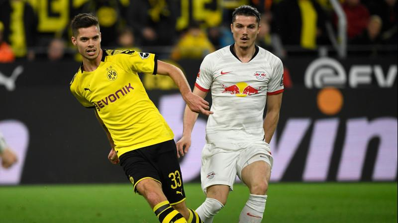 Dortmund, having won their previous three league games, looked to be cruising to victory when Julian Weigl fired in to give them the lead in the 23rd minute. (Photo:AFP)