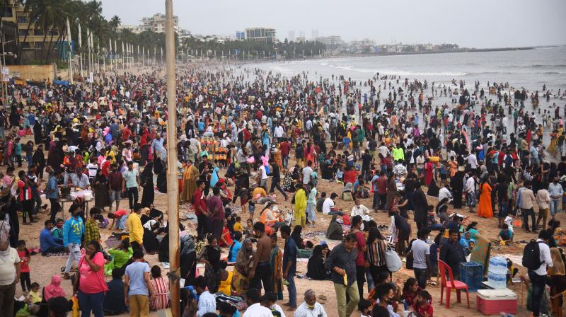 People gather in large number at the Juhu beach after authorities allowed opening of beaches for public, in Mumbai. (Photo: PTI)
