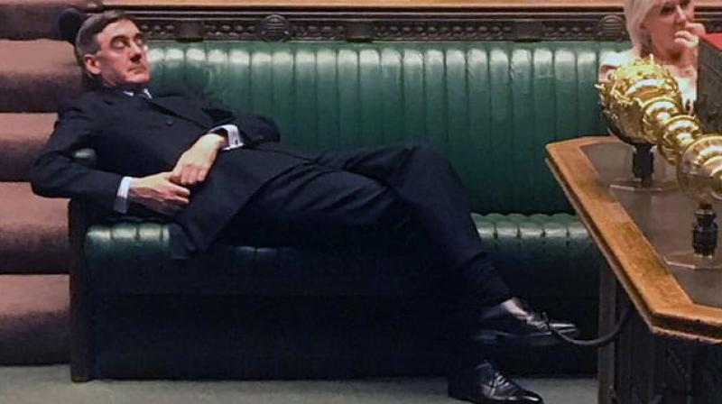 With his tiny round glasses pointing at the ceiling and wearing a double-breasted suit, Rees-Mogg appeared to be taking a rest in the crucial final minutes before a crunch Brexit vote on Tuesday night lit up Twitter. (Photo: AFP)