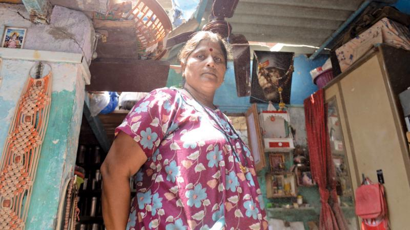 A resident stands underneath the damaged roof of her house in Wadala. (Photo: Rajesh Jadhav)