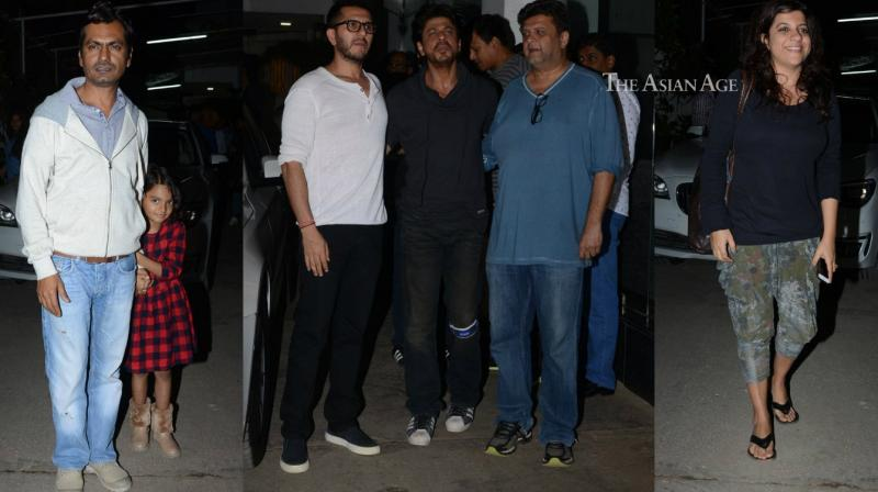 Shah Rukh Khan and the team of his upcoming film 'Raees' were seen at the first screening of the film in Mumbai on Thursday. (Photo: Viral Bhayani)
