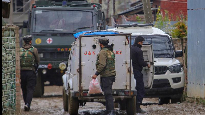 Security forces cordon off area during an encounter with militants amid nationwide lockdown at Sopore in Baramulla. PTI photo