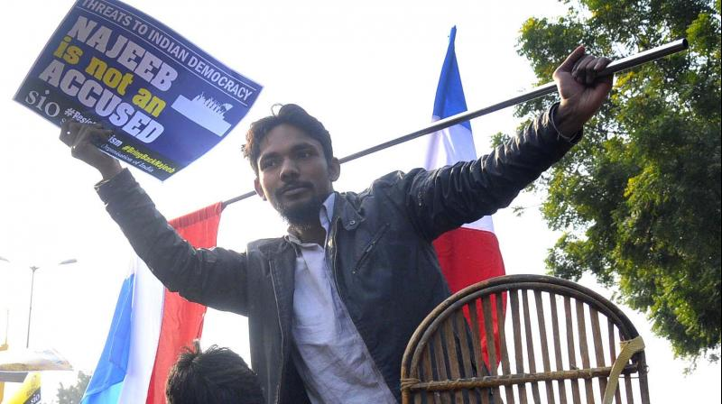 Students protest outside police HQ against raid at Najeeb Ahmed kin's residence. (Photo: Bunny Smith)