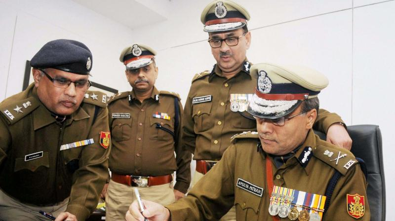 New commissioner of police Amulya Patnaik takes charge from his predecessor Alok Kumar Verma in New Delhi. (Photo: PTI)