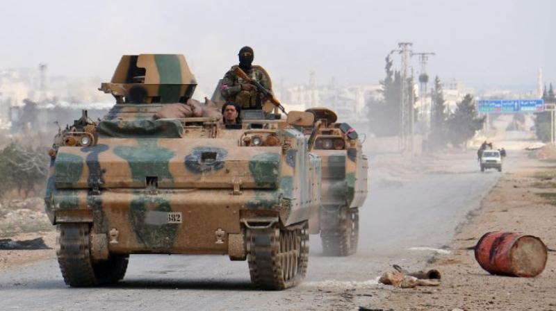 Turkey-backed opposition fighters advance in an armoured personnel carrier outside the northern Syrian town of al-Bab during a drive to retake control from the Islamic State group on February 9, 2017 (Photo: AFP)