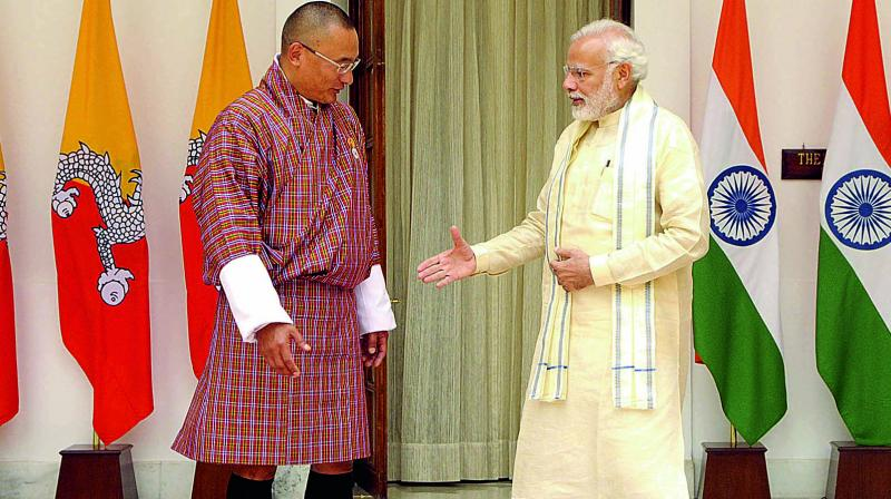 Prime Minister Narendra Modi shakes hand with his Bhutanese counterpart Tshering Tobgay in New Delhi. (Photo: Pritam Bandyopadhyay)