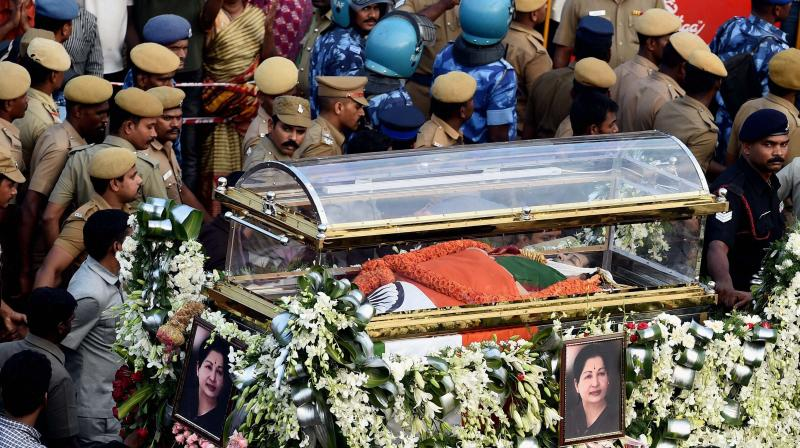 J Jayalalithaa was on Tuesday evening laid to rest next to her mentor MGR on the Marina Beach in Chennai with full state honours. (Photo: PTI)