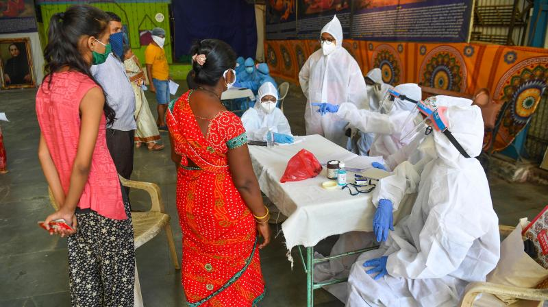 Doctors and medical staff attend residents at a COVID-19 coronavirus community clinic during a nationwide lockdown imposed as a preventive measure against the COVID-19 coronavirus, in Mumbai. PTI Photo