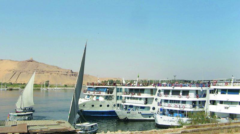 Traditional feluccas and modern cruise ships on the Nile