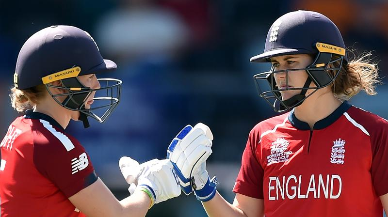 England's in-form batswomen Heather Knight (left) and Nathalie Sciver hold the key to the semifinal against India. AFP Photo