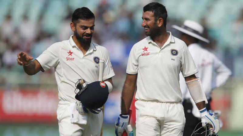 Virat Kohli, unbeaten on 151, and Cheteshwar Pujara (119) put together a marathon 226-run stand for the third wicket. (Photo: AP)