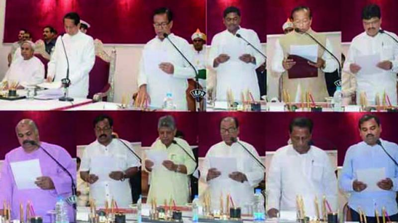 The new ministers take oath in Bhubaneswar. (Photo: Asian Age)