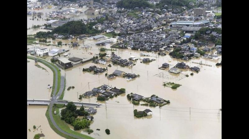 In Saga Prefecture, in the Kyushu region, the main railway station was flooded and a number of vehicles were seen submerged. A number of landslides were also reported. (Photo: ANI)