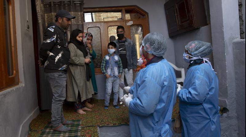 Kashmiri health workers talk to local residents during a contact-tracing drive after the first person in the region tested positive on March 19, 2020. (Representative Image | AP)