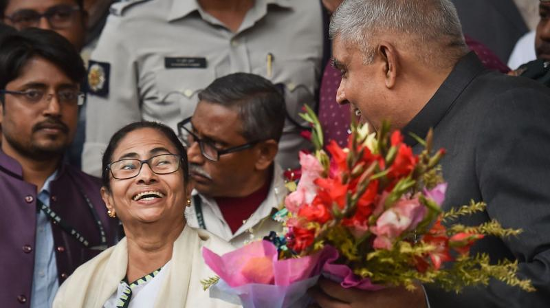 West Bengal governor Jagdeep Dhankar (right) and chief minister Mamata Banerjee. (PTI)