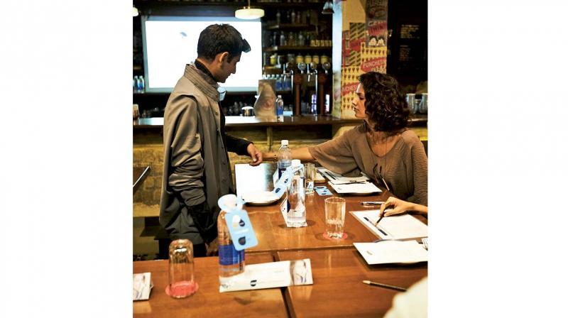 Model Sheetal Mallar judging a garmet.