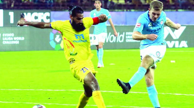 Melbourne City FC's Biley McGree (right) scores against Kerala Blasters in Kochi on Tuesday. MCFC won 6-0. (Photo: Arun Chandrabose)