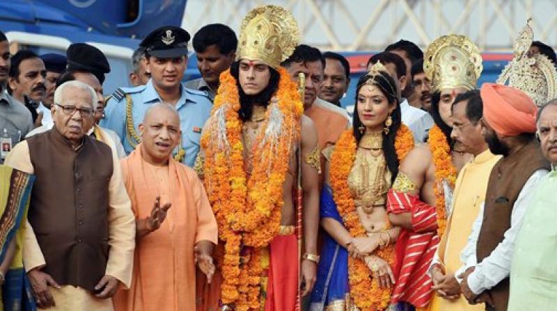 Uttar Pradesh Governor Ram Naik and Chief Minister Yogi Adityanath with artistes dressed up as Lord Rama, Sita and Lakshman during Deepotsav celebrations in Ayodhya on Wednesday. (Photo: PTI)