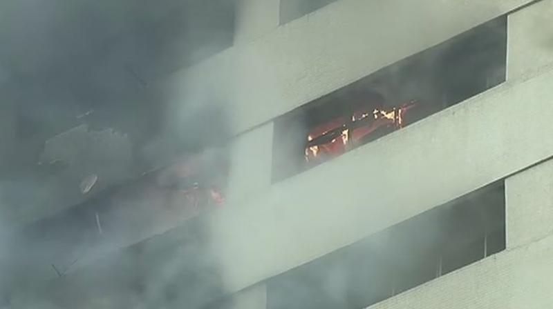 Fire breaks out at LIC building on Jawahar Lal Nehru road. (Photo: ANI)