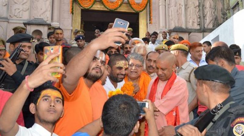 Uttar Pradesh Chief Minister Yogi Adityanath coming out from Hanuman Garhi Mandir Ayodhya on Thursday. (Photo: PTI)
