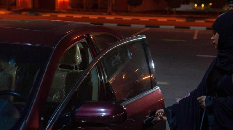 A Saudi woman gets ready to drive her car through the streets of Khobar City on her way to Kingdom of Bahrain. (Photo:Representational   AFP)
