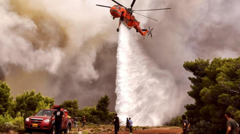 Hundreds of firefighters, as well as several aircraft and helicopters have been mobilised to fight the fires in Greece. (Photo: AFP)