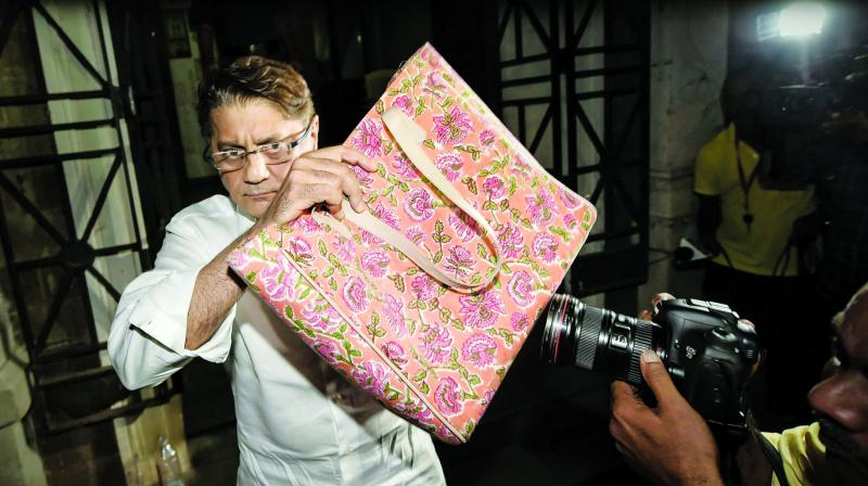 Deepak Kochhar leaves ED office after questioning. (Photo: PTI)