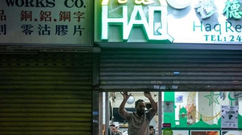 """Employees at 11 restaurants and shops in Beijing selling halal products and visited by Reuters in recent days said officials had told them to remove images associated with Islam, such as the crescent moon and the word """"halal"""" written in Arabic, from signs. (Photo: AFP)"""