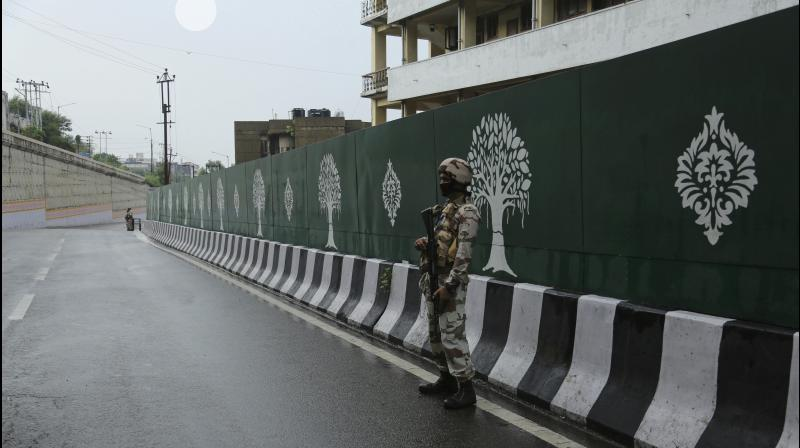 File photo of a paramilitary soldier standing guard on a road in in Jammu last week. Tensions have been bubbling in Jammu over a social media video in which two men allegedly blasphemed Prophet Muhammad. (AP file photo)