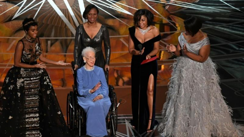 NASA physicist Katherine Johnson (C), whose likeness is set to be made into a Lego, is surrounded by Hidden Figures actresses Janelle Monae (L), Taraji P. Henson (2ndR) and Octavia Spencer (R) as they present on stage at the Oscars February 26, 2017 (Photo: AFP)