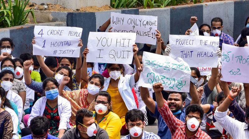 PG doctors stage a protest against alleged misbehavior and manhandling of doctors treating COVID-19 patients during the nationwide lockdown, near Gandhi Hospital in Hyderabad. PTI photo